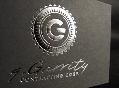 silver foil letterpress printed business card on grey paper