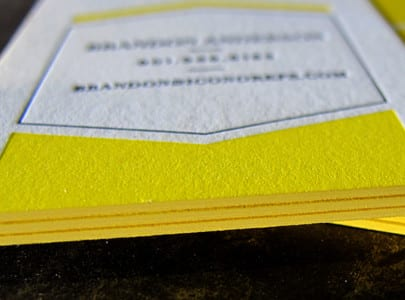 Letterpress printed business card with black and yellow ink, and matching yellow edge painting for Icono