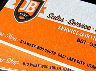 letterpress printed business card with orange and black ink for JB Tire