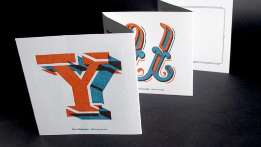 custom letterpress printed thank you with two color orange and blue deboss