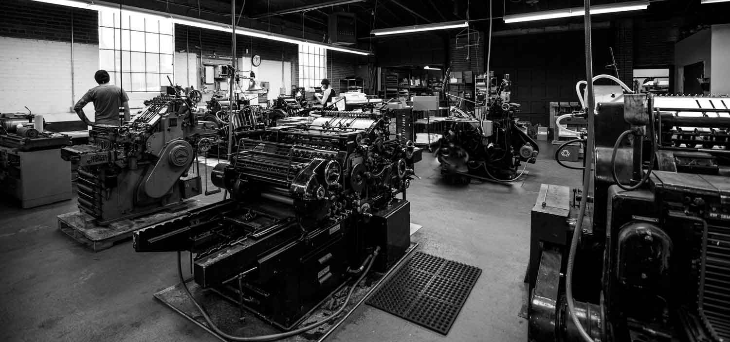 several letterpress printing presses in the production room at The Mandate Press