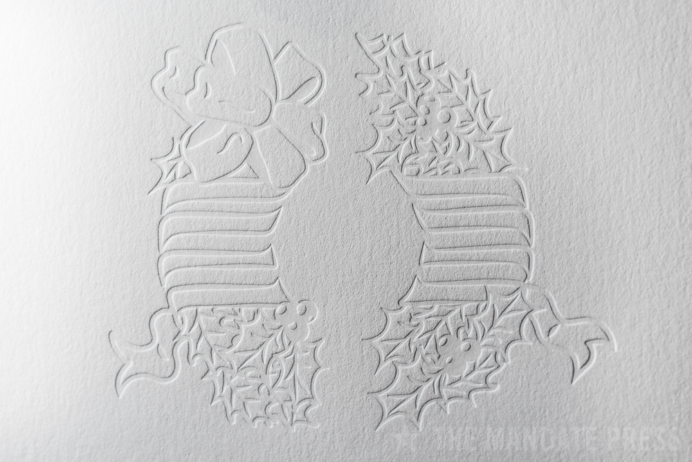 image of inkless blind letterpress printed wreath deboss