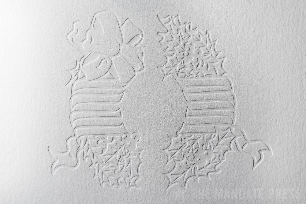 image of inkless blind letterpress printed wreath deboss