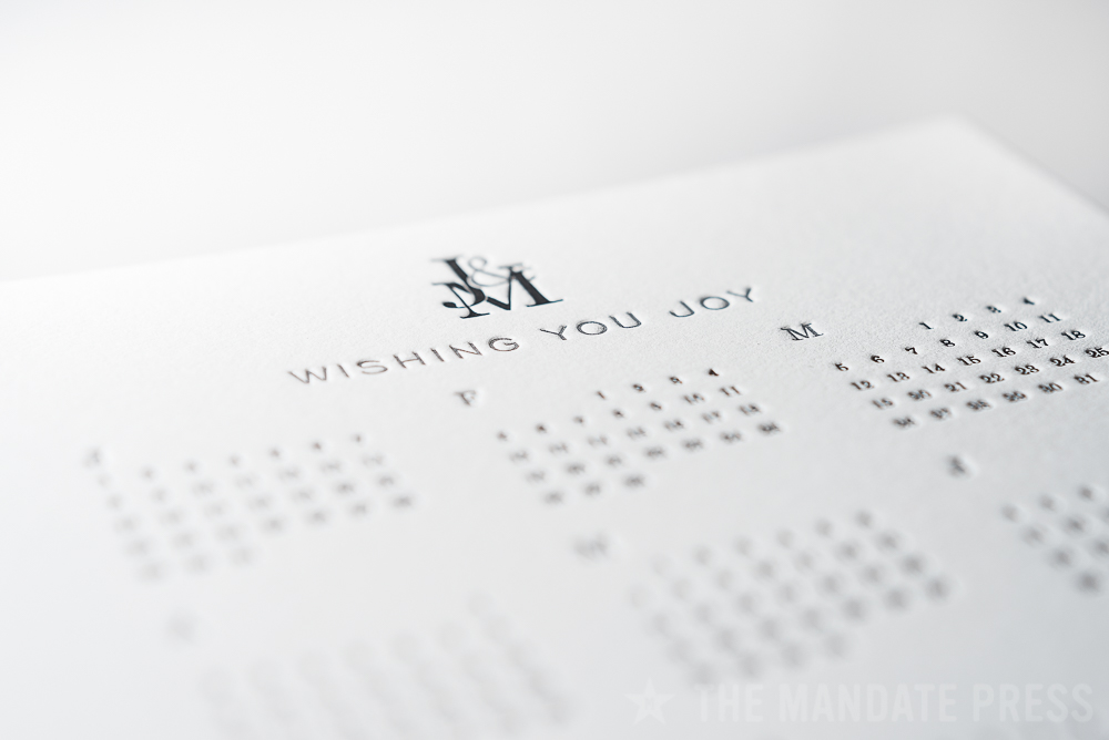image of letterpress printed calendar holiday wishing you joy