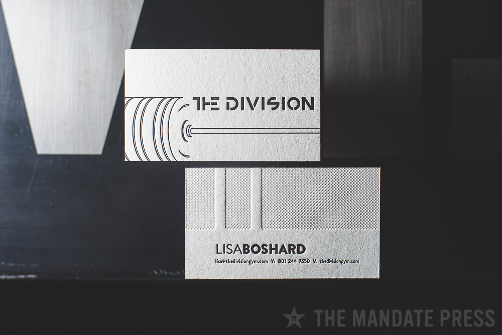 image of letterpress business card for The Division Gym with blind deboss