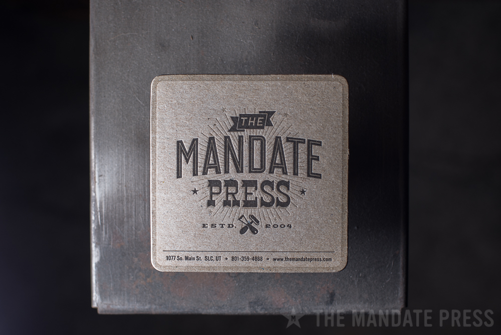 coaster on chipboard two color letterpress printed for The Mandate Press