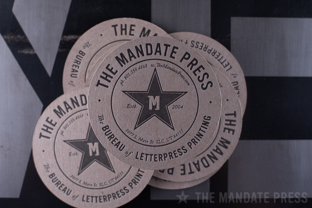 round coaster letterpress printed for The Mandate Press on chipboard