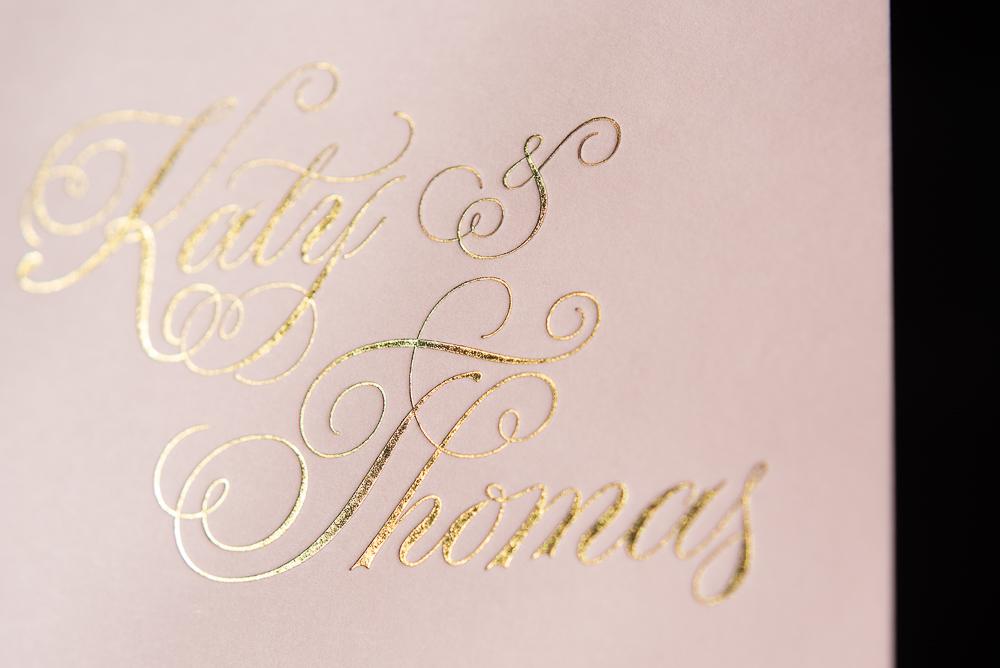 letterpress printed gold foil on pink metallic paper wedding invite