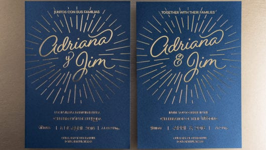 letterpress gold foil on blue paper wedding invitation english spanish