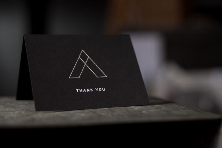 Letterpress thank you card with silver foil on black paper