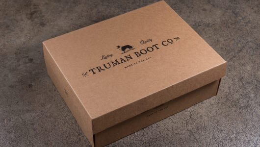 cardboard shoe box with black ink side