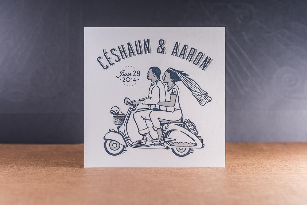 letterpress printed two color wedding invite with couple on scooter