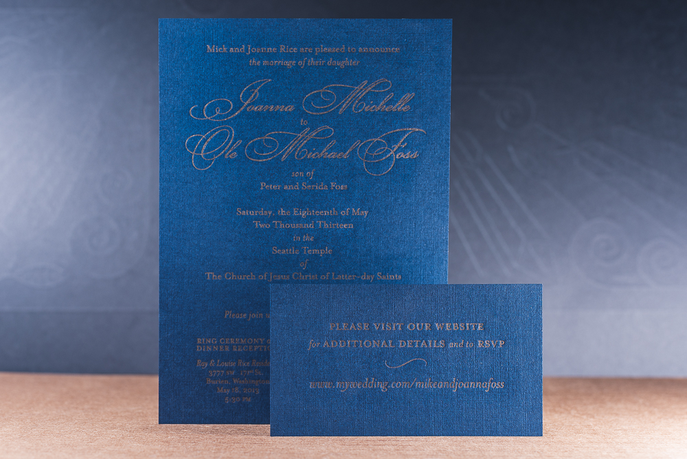 letterpress printed wedding invite gold ink on blue paper with linen texture