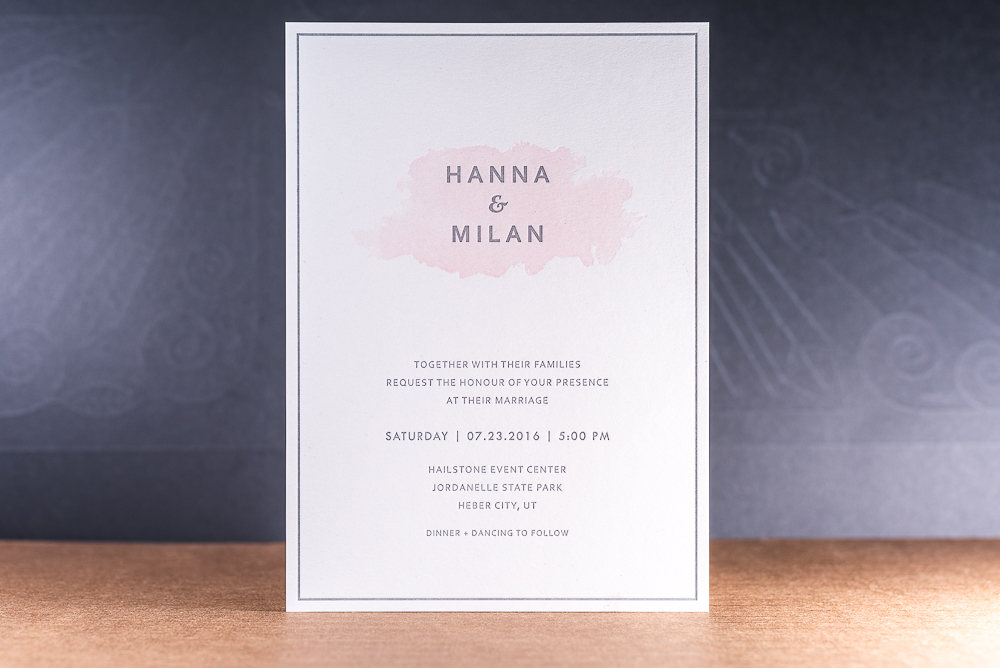 letterpress printed wedding invitation with pink watercolor effect