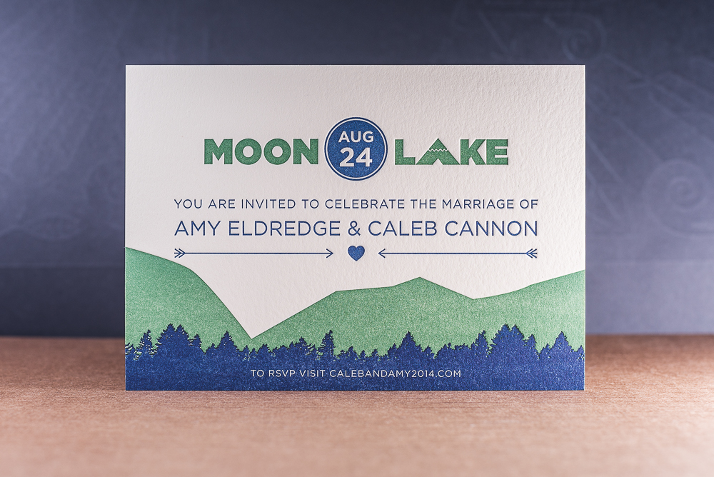 two color letterpress printed wedding invitation with mountains and trees on pearl lettra