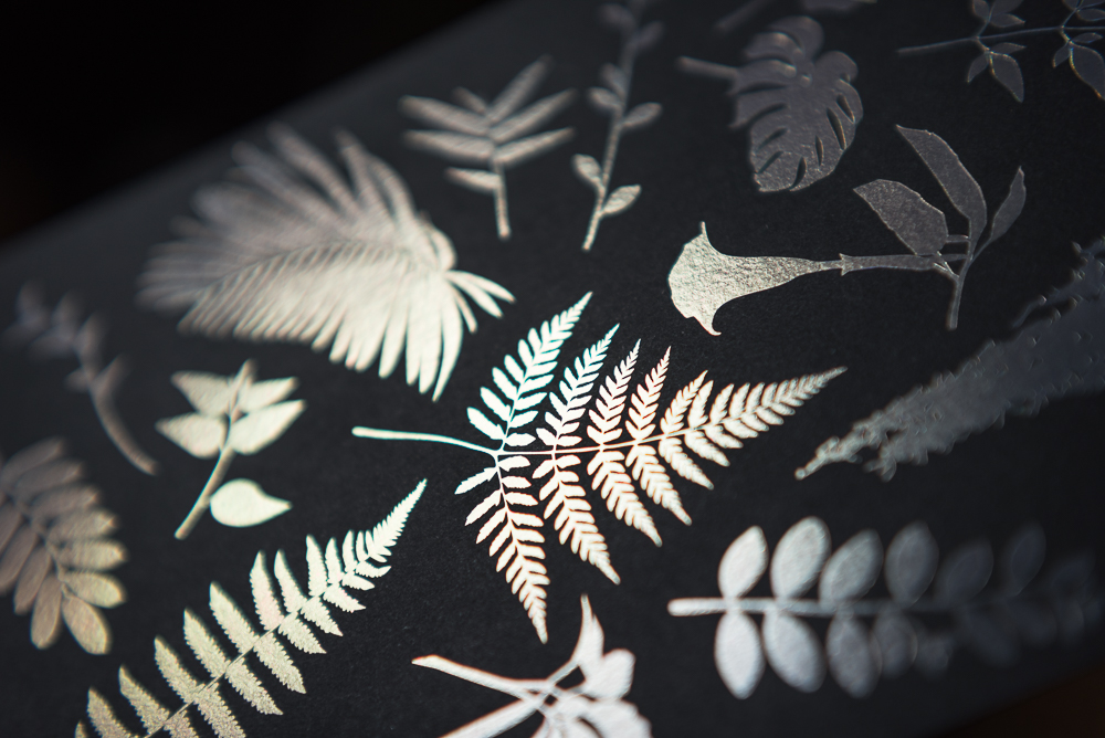letterpress printed leaves with holographic foil shown at angle without color