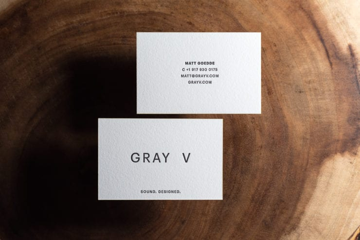 two sided black ink letterpress business card with yellow edge