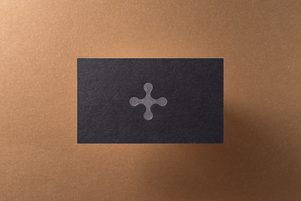 letter press business card on black paper with silver ink