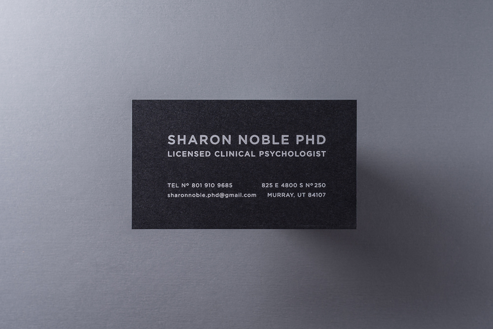 business card with white foil on black paper