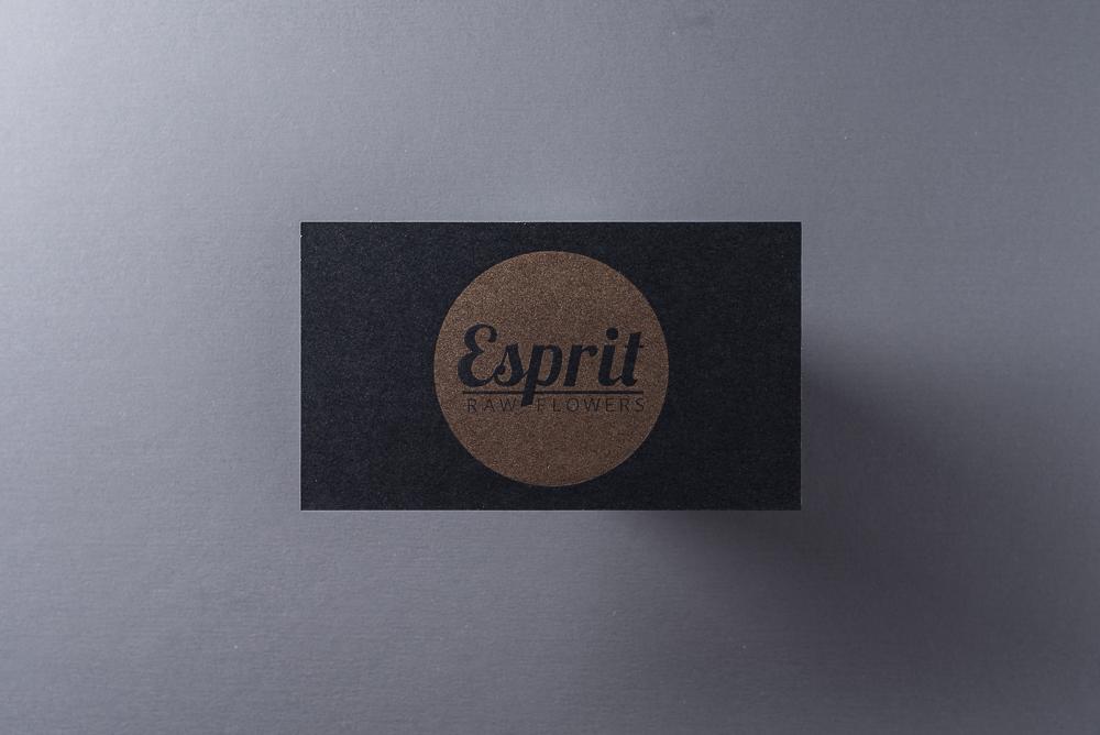 business card with gold metallic ink on black paper
